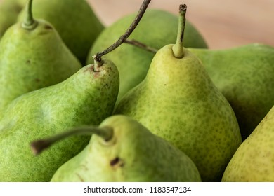 Some freshly harvested pears on a table.