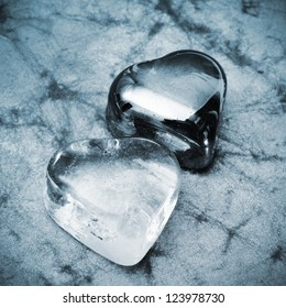 some glass hearts on a marbled background in black and white