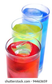 some glasses with cocktails of different colors on a yellow background