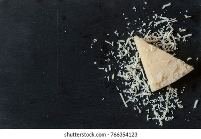 Some grated cheese is on wooden background
