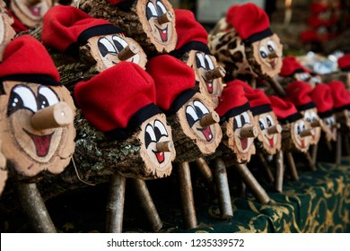 some handmade tio de nadal, a typical christmas character of catalonia, spain, on sale in a christmas market