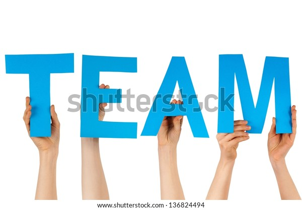 some hands holding the charakters TEAM in blue, isolated