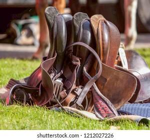 Some Horse sadddles on grass