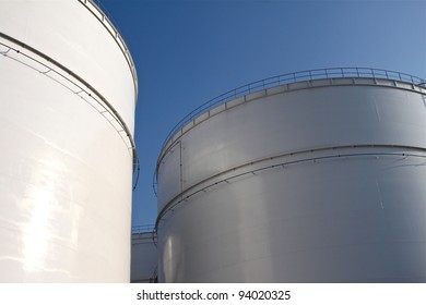 Some huge storage tanks of an oil refinery