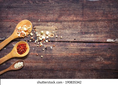 Some kind of spices in wooden spoon