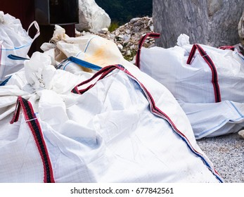 Some large bags containing processing waste