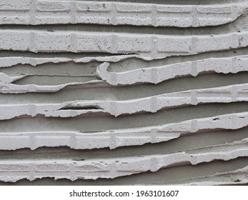 some layers of cemnet on an old stone wall