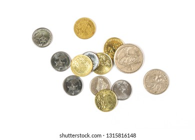some Malaysian Ringgit coins on a white surface
