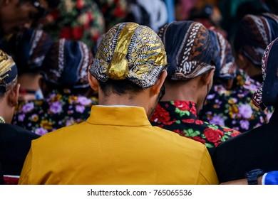 some man in Java wearing Kebaya and Blangkon in their Head