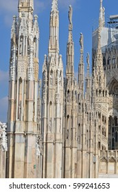 Some of the many hundreds of splendid statues on the roof of Milan Cathedral, Italy.