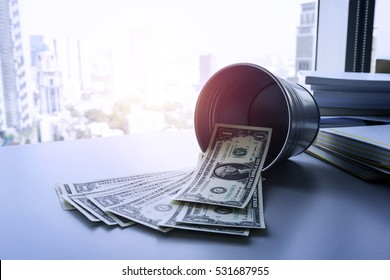 Some money  dollar bills with bucket on table for saving money  concept