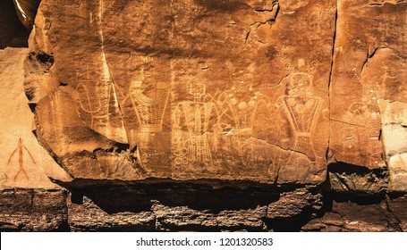 Some of the most ornate anthropomorph petroglyphs by the ancient Fremont people, including warriors (ancient aliens?), and severed heads on Mcconckie Ranch in Dry Fork Canyon, near Vernal, Utah, USA.
