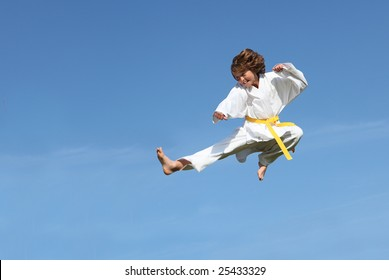 (SOME MOTION BLUR)Karate kid doing karate kick