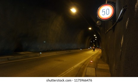 Some motorbike in the stone illuminated tunnel