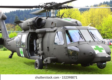 Some natural and man made disasters require rescue services. This is a Blackhawk helicopter being used in a mock disaster relief rescue to transport victims to the hospital.