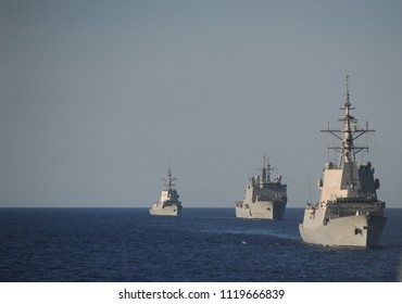 Some navy ships in the pacific ocean during a carrier strike group. Military ships at sea.