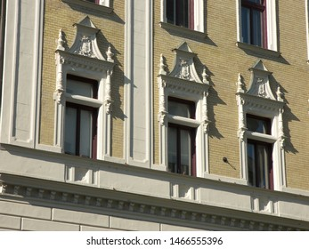 Some neoclassic windows decorate this palace.