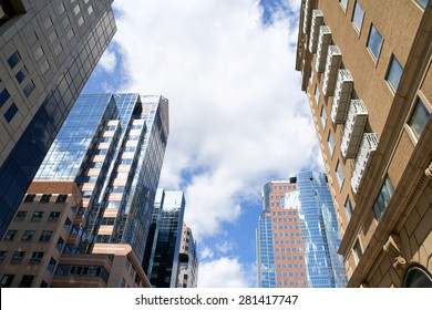 Some office and residential skyscrapers against a cloudy sky in downtown Montreal, Quebec, Canada.