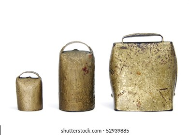 some old cowbells isolated on a white background