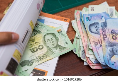 Some people are hiding or saving banknote in a book. In this case is Thai baht. One story talking about husband keep money and don't tell wife.
