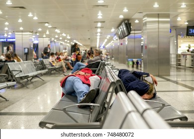 some people lay down sleep at the airport waiting for connecting fight