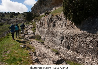 some people visiting iberic ruins in albacete, spain