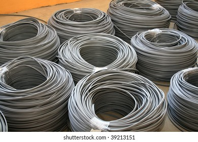 Some piles of gray industrial cables