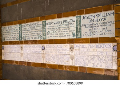 Some of the plaques at the Memorial to Heroic Self-Sacrifice located in Postmans Park in the City of London, UK. The memorial is dedicated to ordinary people who died while saving the lives of others.