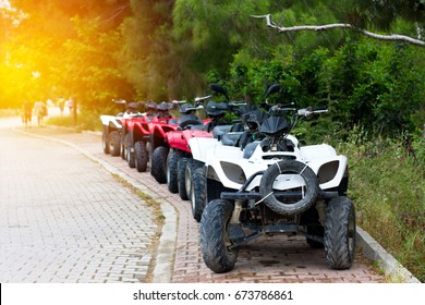 Some quad bikes standing near road, travel concept