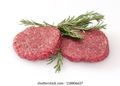 some raw hamburgers isolated on white background