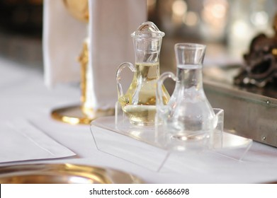Some religious accessories: bottles of wine and holy water