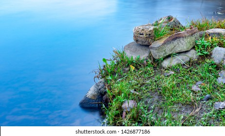 Some rocks in river coat line, calm water, early autumn in northern Europe wildlife
