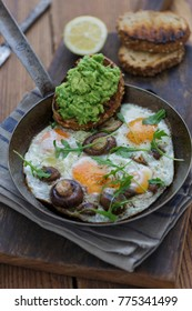 some scrambled eggs with mushrooms and avocado bread