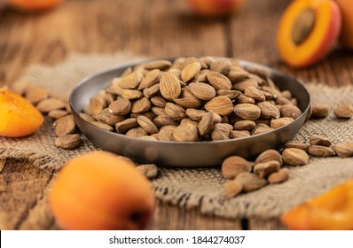 Some shelled Apricot Kernels as detailed close up shot (selective focus)