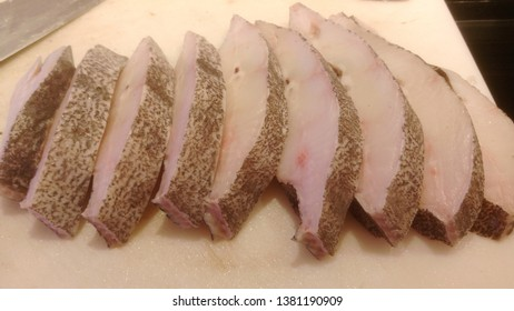 some sliced raw flatfish in a market
