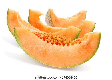 some slices of Persian melon on a white background