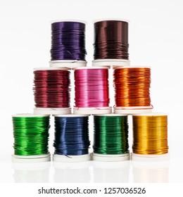 Some  spools of colored metallic thread