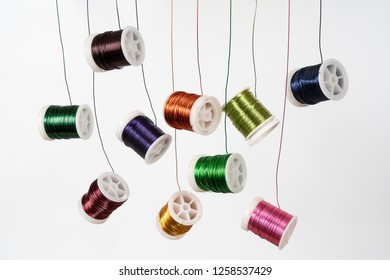 Some  spools of colored metallic thread