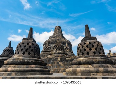 Some stupas in Borobudur Temple, Magelang, Indonesia. The main stupa is the back at the middle. Borobudur will be the location to celebrate Vesak Day 2019.