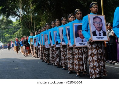 Some teenagers in Wonosobo Central Java Indonesia, bring a old residen photo. wearing Batik cloth and Blangkon in their head to celebrate their city birthday. Monday 24 July 2017