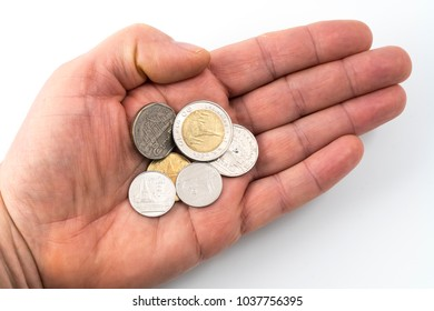 some Thai coins  on a hand