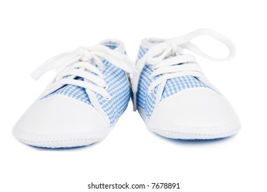 Some tiny baby shoes isolated on white