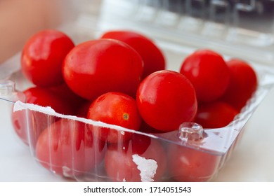 some tomatoes on a plastic recipient