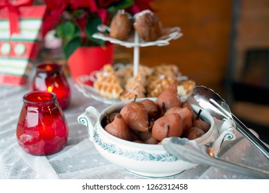 Some traditional dutch food: oliebollen (oil balls), wafels (waffles) and stoofpeertjes (stewed pears). Served at a Christmas market.