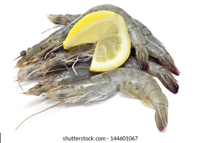 some uncooked tiger prawns on a white background