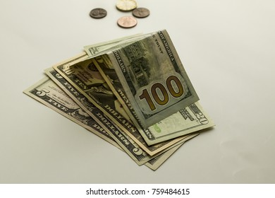 Some United States Dollars on the white background with some coins,isolated.