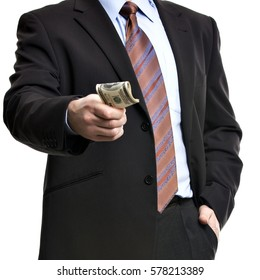 Some unrecognizable Businessman in suit showing  a Spread of Cash, Isolated on white background. Man with dollars symbolizing Success, Motivation, Wealth.