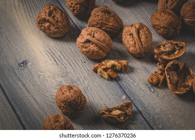 Some walnuts on a wooden table top