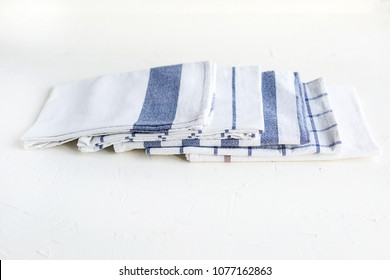 Some white cotton napkins on the kitchen table. Ecofriendly fabric and lifestyle.