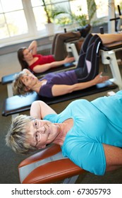 Some women doing crunches in a gym